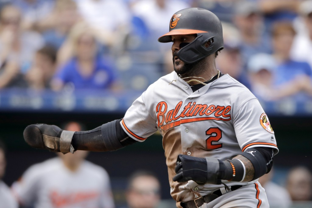 Baltimore Orioles' Jonathan Villar runs home to score on a fielder's choice hit into by Pedro Severino during the sixth inning of a baseball game agai...