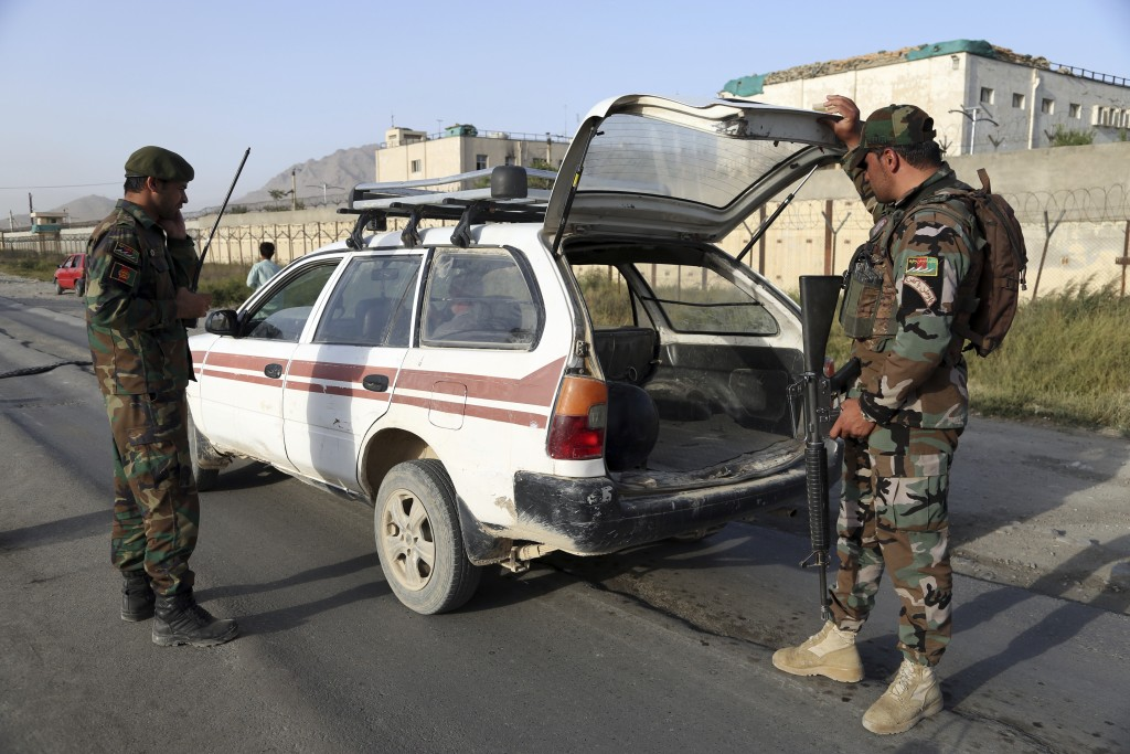 In this Tuesday, Sept. 10, 2019, photo, Afghan National army soldiers search a vehicle at a checkpoint in Kabul, Afghanistan. President Donald Trump s...