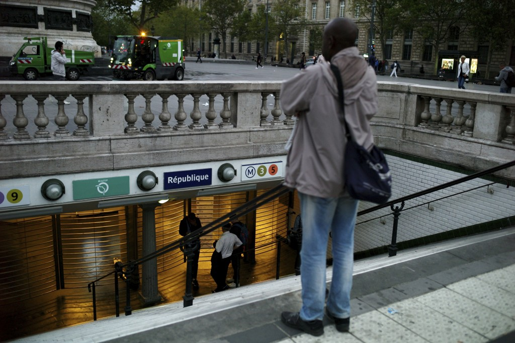 A man stands in front of the closed gate of the Republique square metro station, in Paris, Friday, Sept. 13, 2019. Paris metro warns over major strike
