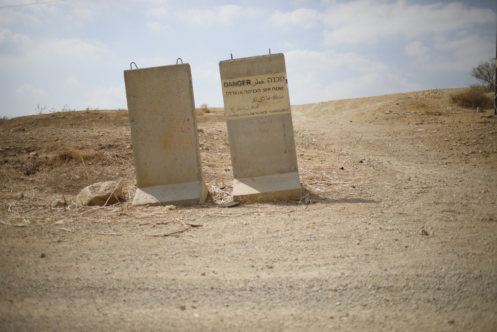 An Israeli military sign warns against entrance to a firing zone, near Bardala, in the Israeli-occupied West Bank, Wednesday, Sept. 11, 2019. Israeli