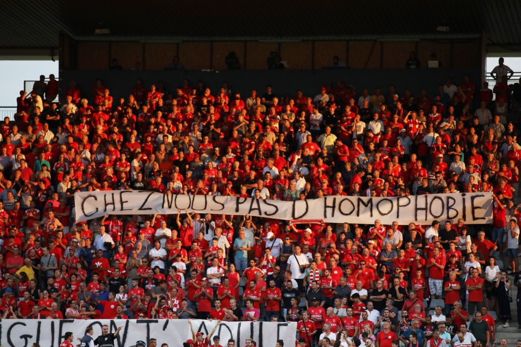 """FILE - In this Saturday, Aug. 31, 2019 file photo, Nimes fans hold up a banner that reads """"with us no homophobia"""" before the start of the French Leagu"""
