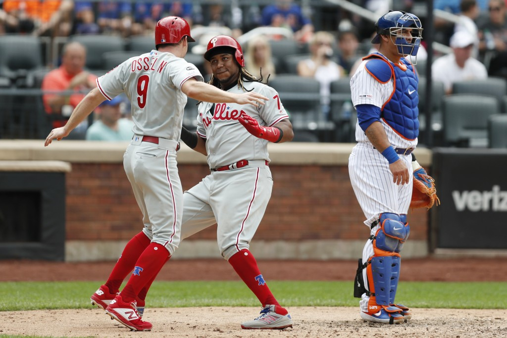 Philadelphia Phillies' Maikel Franco (7) celebrates with the Phillies' Phil Gosselin (9) after hitting a two-run, home run during the sixth inning in