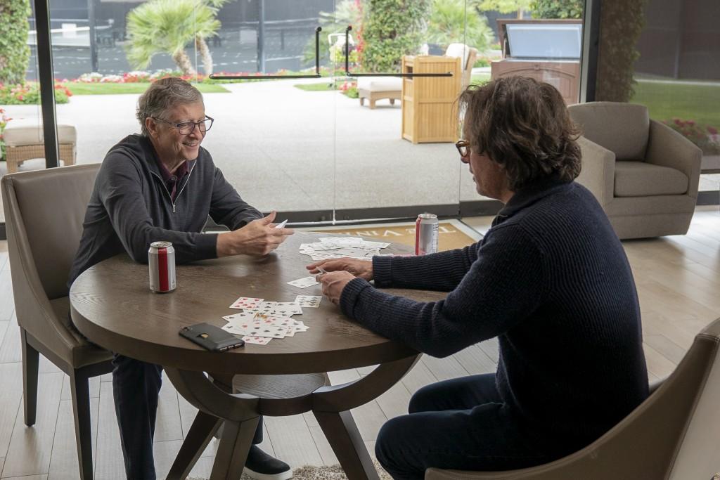 "This image released by Netflix shows billionaire philanthropist Bill Gates, left, and filmmaker Davis Guggenheim from ""Inside Bill's Brain: Decoding B"