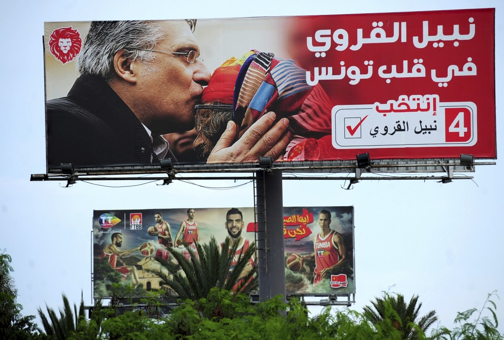 An electoral poster for jailed presidential candidate Nabil Karoui is pictured Tuesday Sept. 10, 2019 in Tunis. Tunisia's 26 presidential candidates l