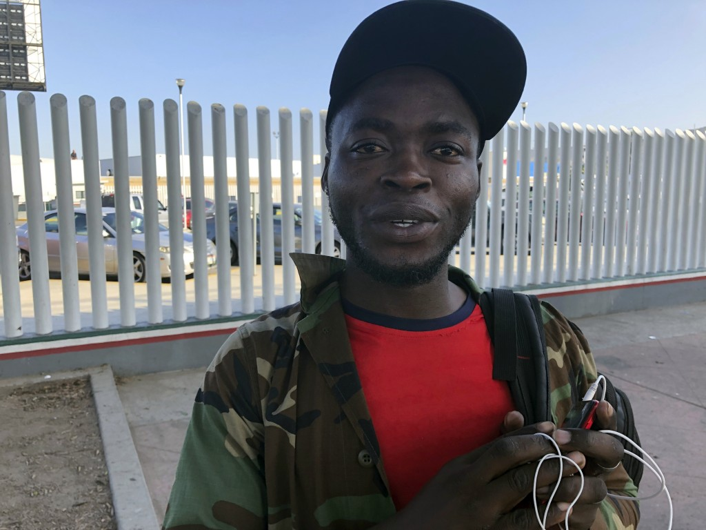 Ngoh Elliot Takere gives an interview in Tijuana, Mexico, where he has been waiting for two months to apply for asylum in the U.S., Thursday, Sept. 12