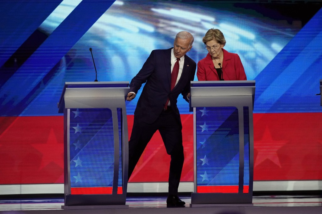 Democratic presidential candidates former Vice President Joe Biden and Sen. Elizabeth Warren, D-Mass. talk during a break Thursday, Sept. 12, 2019, at