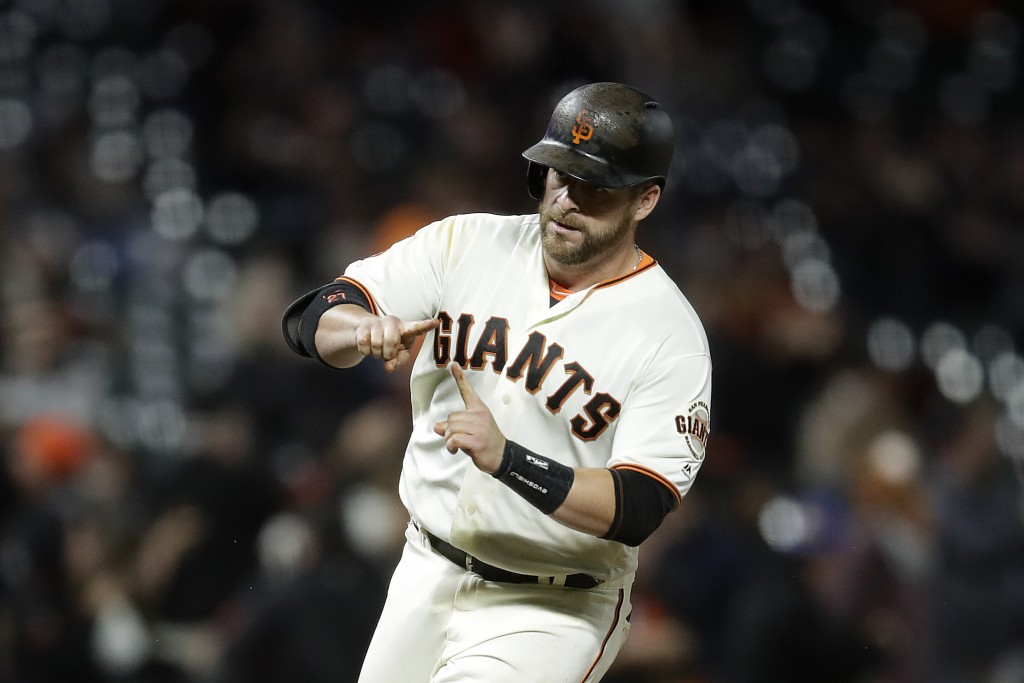 San Francisco Giants' Stephen Vogt celebrates after hitting a two-run home run off Pittsburgh Pirates pitcher Mitch Keller during the fifth inning of