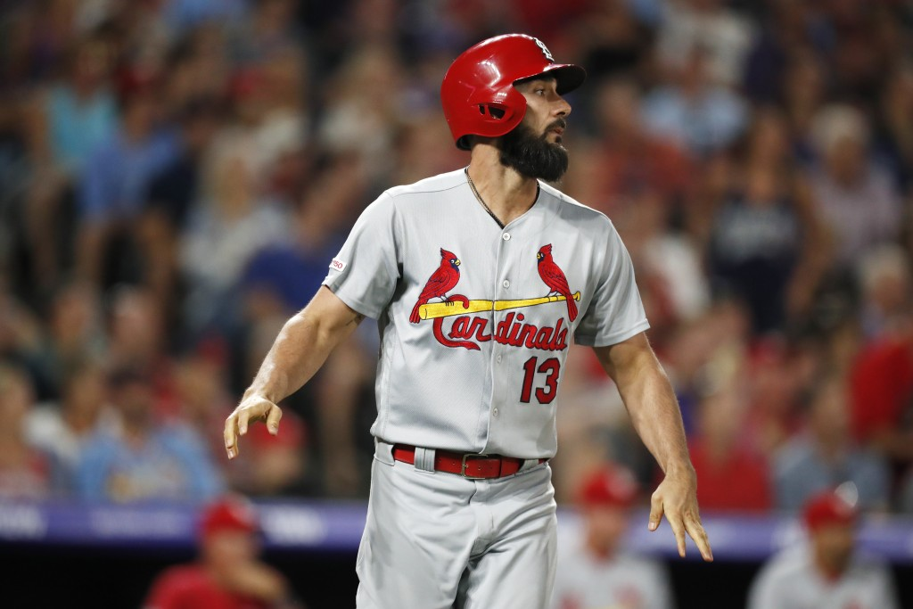 St. Louis Cardinals pinch-hitter Matt Carpenter reacts after hitting a soft liner for an out to Colorado Rockies shortstop Trevor Story with the bases