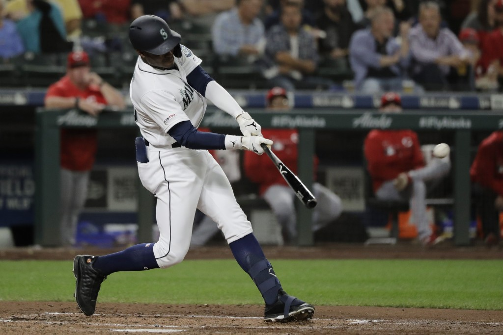 Seattle Mariners' Kyle Lewis hits a double against the Cincinnati Reds during the second inning of a baseball game, Thursday, Sept. 12, 2019, in Seatt...