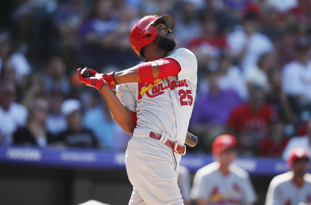 St. Louis Cardinals' Dexter Fowler singles against Colorado Rockies relief pitcher DJ Johnson in the sixth inning of a baseball game Thursday, Sept. 1...