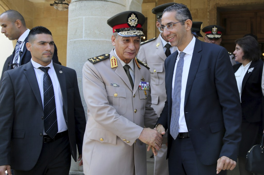 Cyprus' defense minister Savvas Angelides, right, shakes hands with his Egyptian counterpart Lt. Gen. Mohamed Ahmed Zak, left, after a meeting with Cy