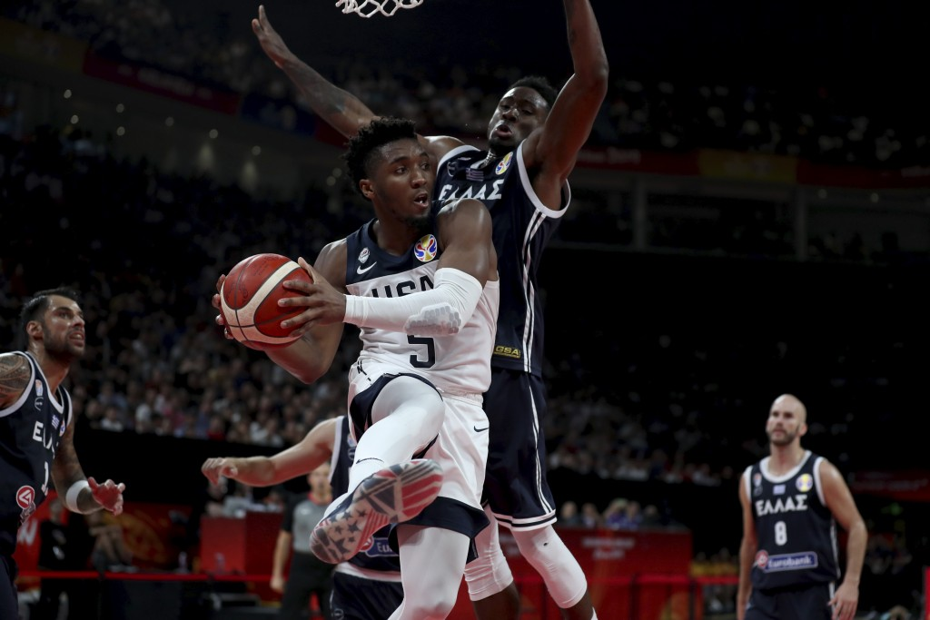 United States' Donovan Mitchell keeps the ball from Greece's Thanasis Antetokounmpo during phase two of the FIBA Basketball World Cup at the Shenzhen ...