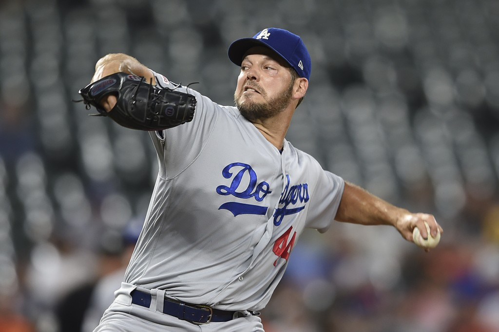 Los Angeles Dodgers pitcher Rich Hill throws against the Baltimore Orioles in the first inning of a baseball game Thursday, Sept. 12, 2019, in Baltimo...