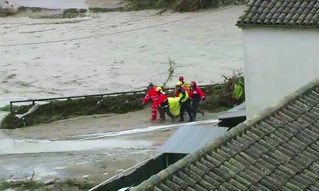 In this image made from video provided by Atlas, emergency services carry an injured woman on a stretcher, in Ontiyente, Spain, Thursday, Sept. 12 201