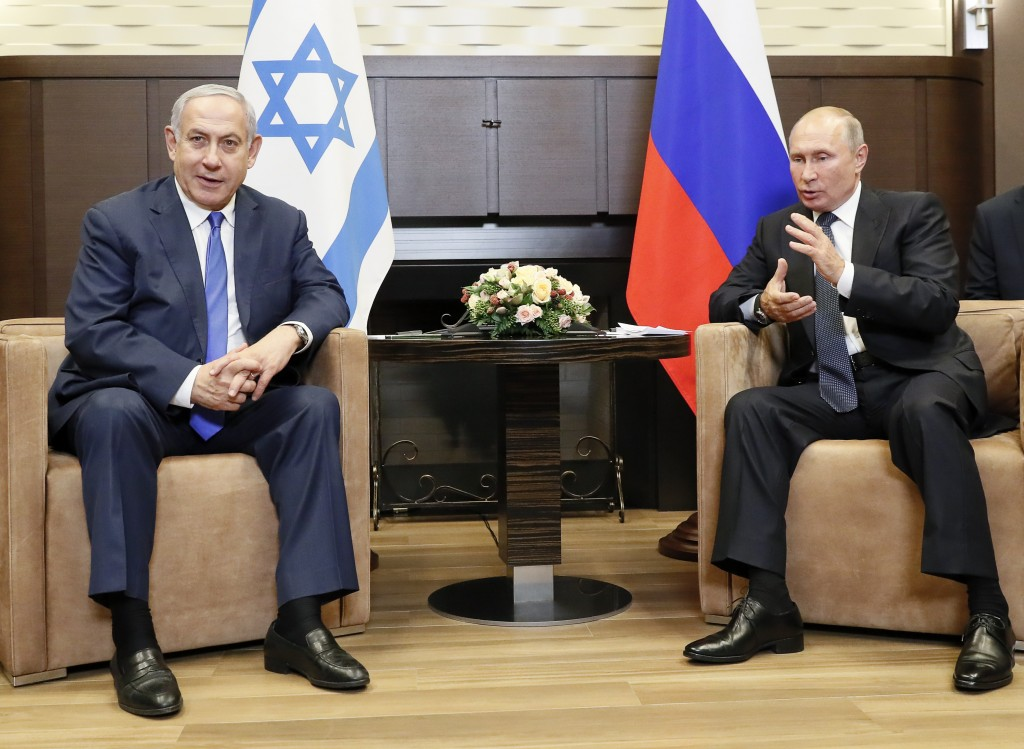 Russian President Vladimir Putin, right, and Israeli Prime Minister Benjamin Netanyahu talk during their meeting in Sochi, Russia, Thursday, Sept. 12,...