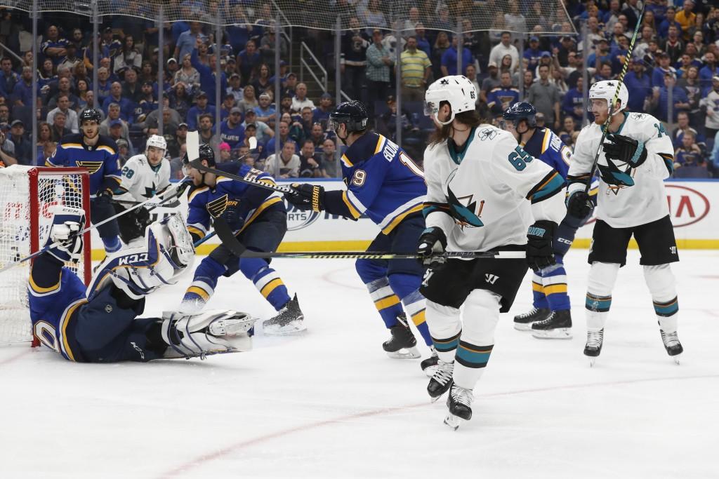 FILE - In this May 15, 2019, file photo, San Jose Sharks defenseman Erik Karlsson (65), of Sweden, scores the winning goal past St. Louis Blues goalte...