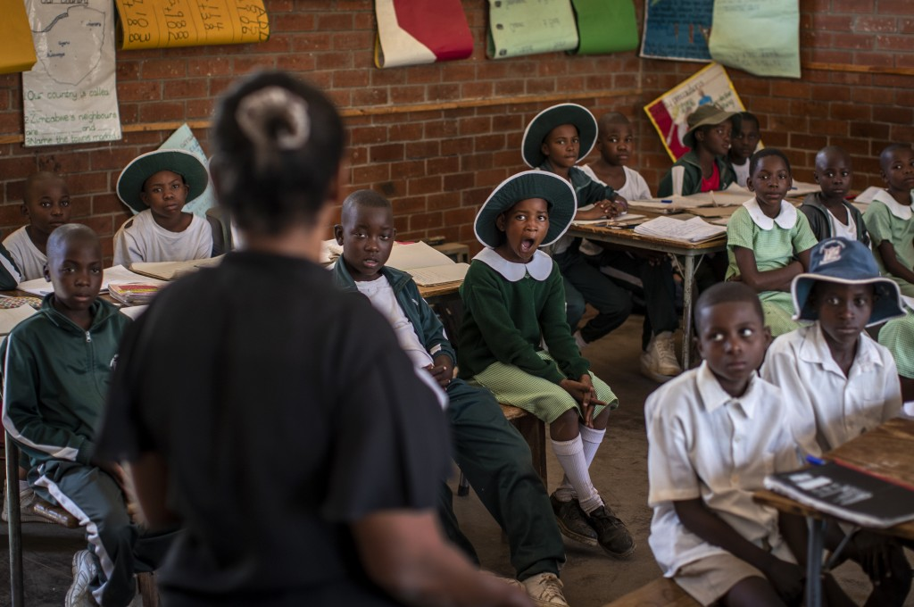 Schoolchildren attend a class in the Shona language on the first day of term at the Vimbai Primary School in Norton, west of the capital Harare, in Zi...