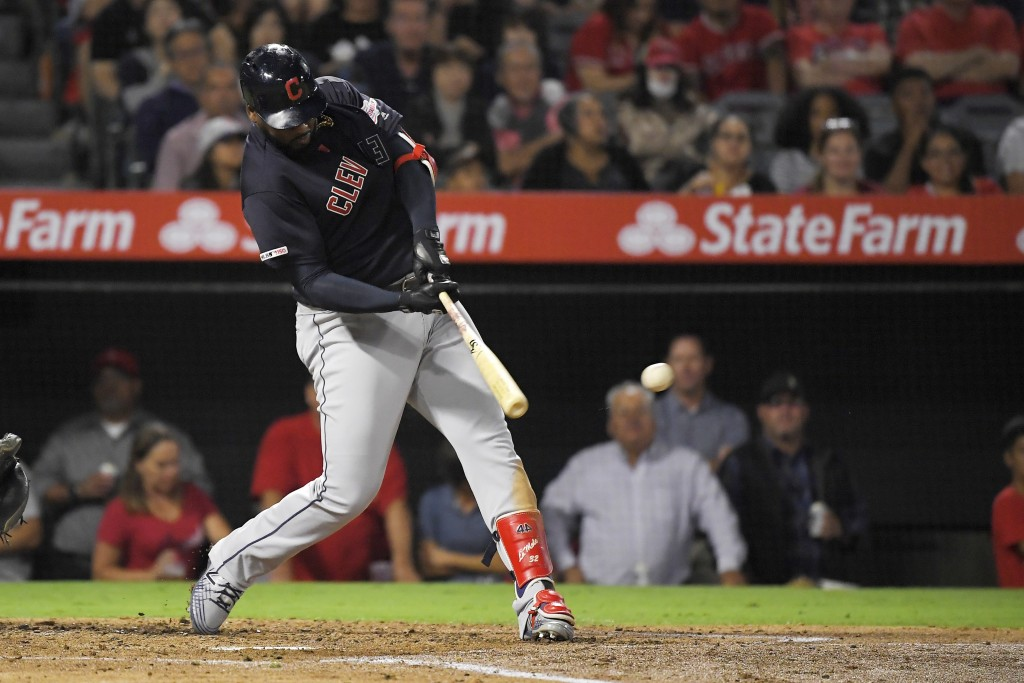 Cleveland Indians' Franmil Reyes hits a three-run double during the third inning of the team's baseball game against the Los Angeles Angels on Tuesday...