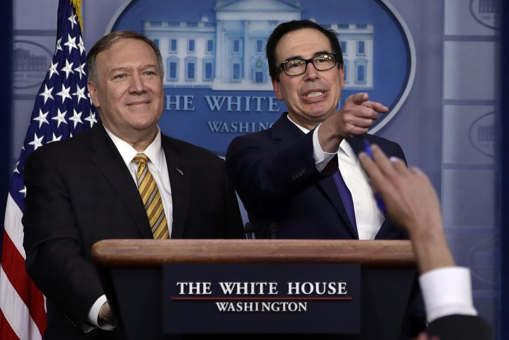 Secretary of State Mike Pompeo and Treasury Secretary Steve Mnuchin take questions during a briefing on terrorism financing at the White House, Tuesda...