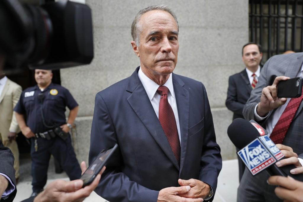 U.S. Rep. Chris Collins, R-N.Y., speaks to reporte...