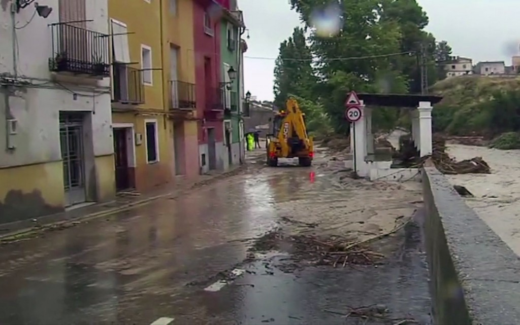 In this image made from video provided by Atlas, the flooded streets are seen in Ontiyente, Spain, Thursday, Sept. 12 2019.  A large area of southeast