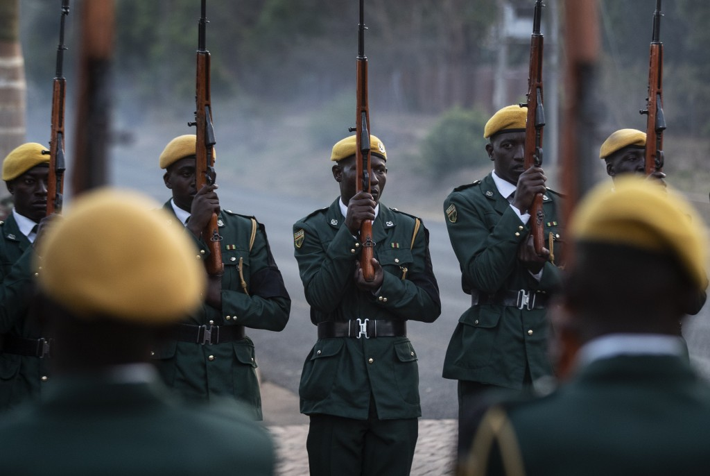 The presidential guard await the arrival of the body of former president Robert Mugabe at his official residence in the capital Harare, Zimbabwe Wedne