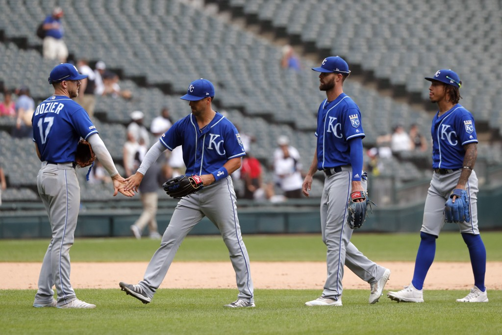 Kansas City Royals' Hunter Dozier (17) celebrate with teammates the team's win over the Chicago White Sox after a baseball game Thursday, Sept. 12, 20