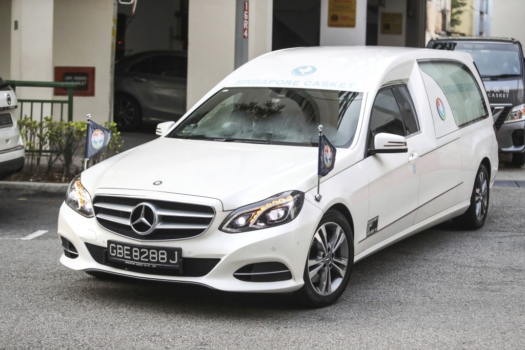 A hearse carrying the body of former Zimbabwe President Robert Mugabe leaves the Singapore Casket Funeral Parlour for the airport in Singapore Wednesd