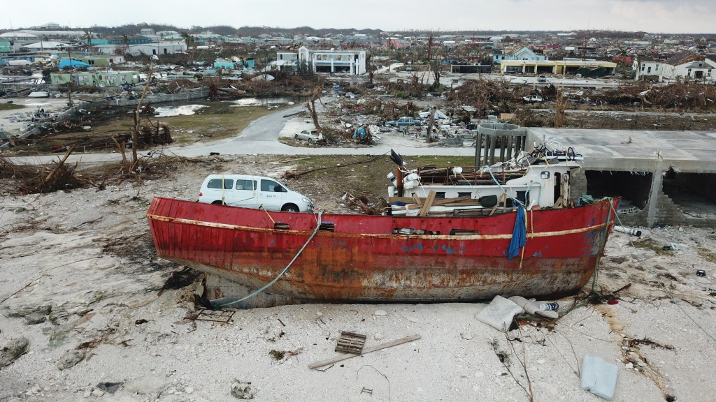 In this Sept. 6, 2019 photo, a boat sits grounded in the aftermath of Hurricane Dorian, in Marsh Harbor, Abaco Island, Bahamas. The Bahamian health mi