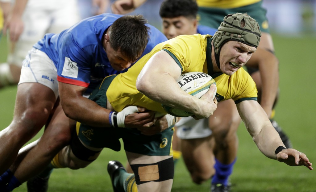 Australia's David Pocock, right, is tackled by Samoa's Jordan Lay during their rugby union test match in Sydney, Saturday, Sept. 7, 2019. (AP Photo/Ri