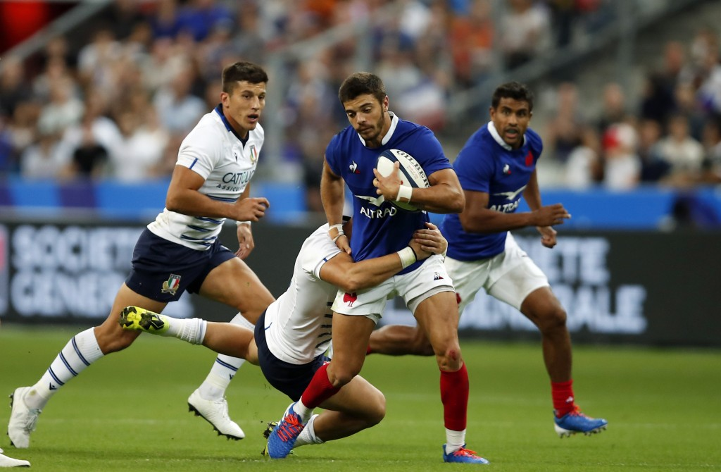 France's Romain Ntamack, front, is tackled by Italy's Michele Campagnaro, back, during a friendly rugby test match between France and Italy at Stade d...