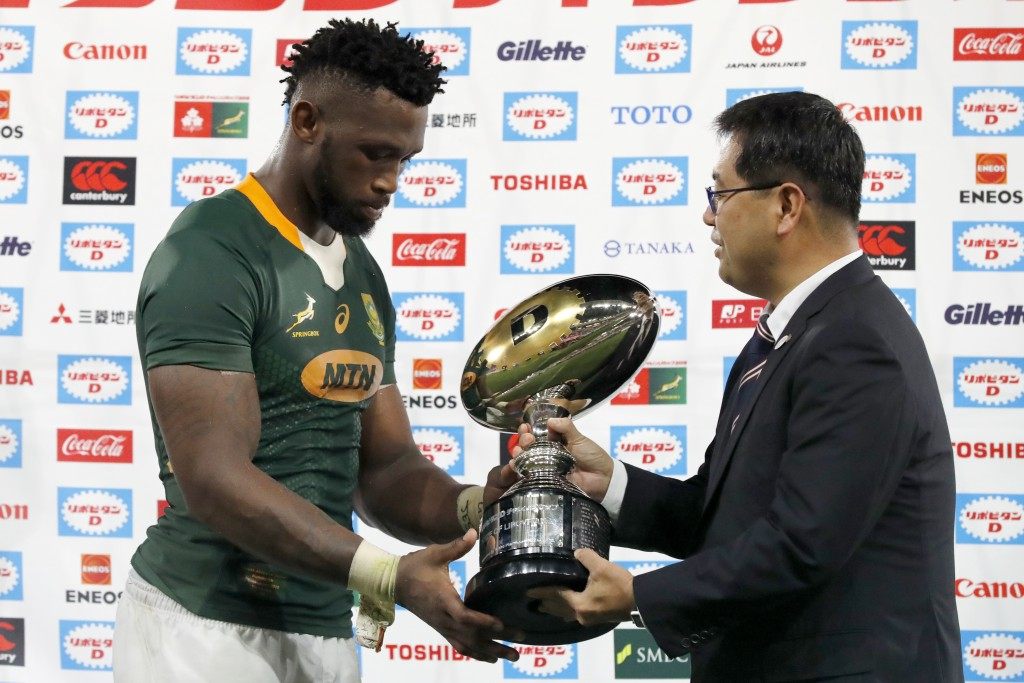 South Africa's Siya Kolisi receives a trophy after a rugby match against Japan at Kumagaya Rugby Stadium Friday, Sept. 6, 2019, in Saitama, Japan. Sou...