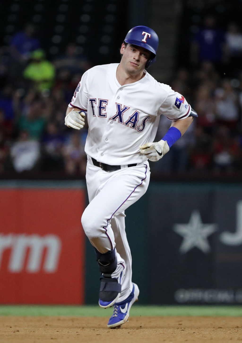 Texas Rangers' Nick Solak runs the bases after hitting a two-run home run against the Tampa Bay Rays during the fourth inning of a baseball game in Ar...