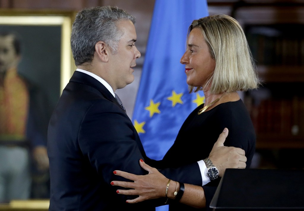 Federica Mogherini, top foreign policy official for the European Union, right, and Colombia's President Ivan Duque embrace after giving a news confere...