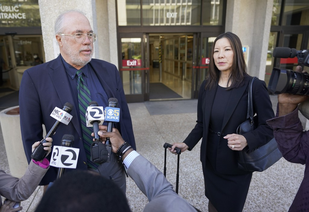 Geoffrey Carr, left, and May Mar attorney's for Tiffany Li, talks with reporters outside the courthouse after opening statements were delayed in Li's
