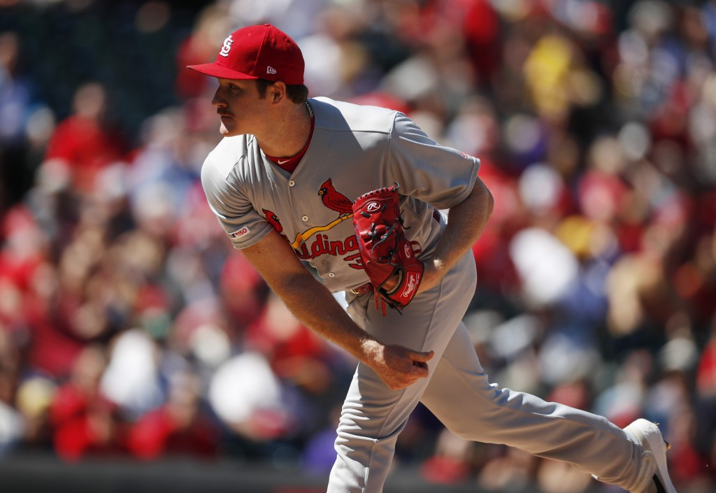 St. Louis Cardinals starting pitcher Miles Mikolas works against the Colorado Rockies in the first inning of a baseball game Thursday, Sept. 12, 2019,...