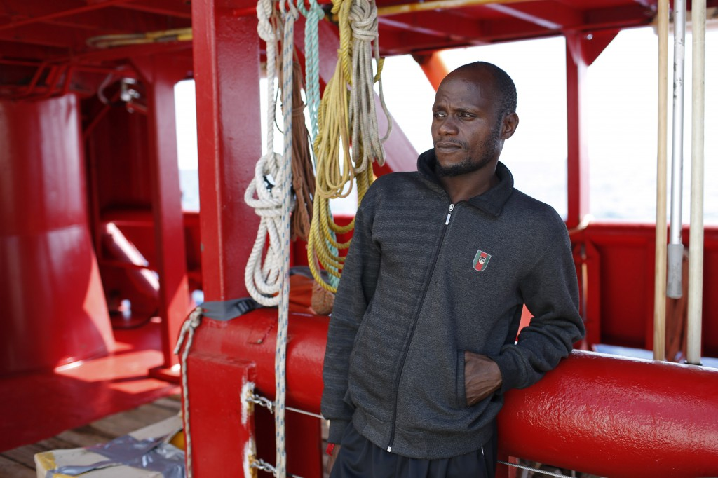Mouctar Diallo, from Guinea, looks out from aboard the Ocean Viking humanitarian rescue ship, in the Mediterranean Sea, Friday, Sept. 13, 2019. Diallo...
