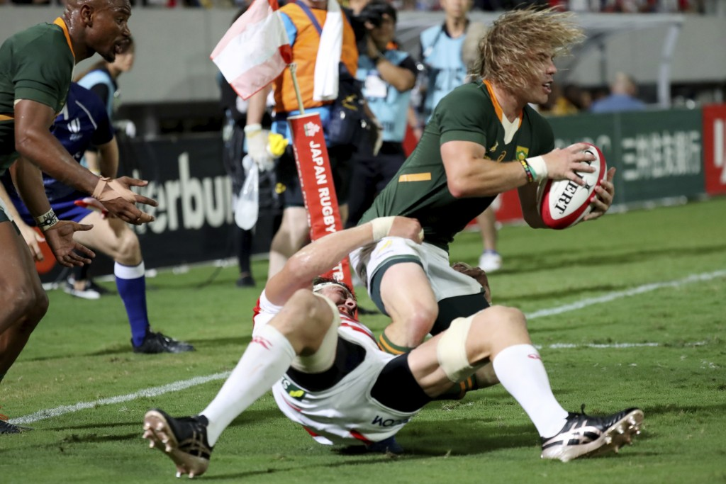 Japan's Luke Thompson tackles South Africa's Faf de Klerk during a rugby match at Kumagaya Rugby Stadium Friday, Sept. 6, 2019, in Saitama, Japan. (AP...
