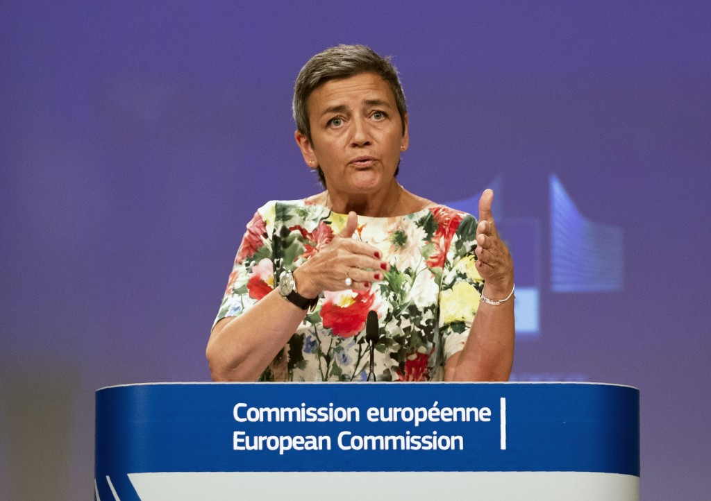 FILE - In this Thursday, July 18, 2019 file photo, European Antitrust Commissioner Margrethe Vestager talks during a news conference at the European C...
