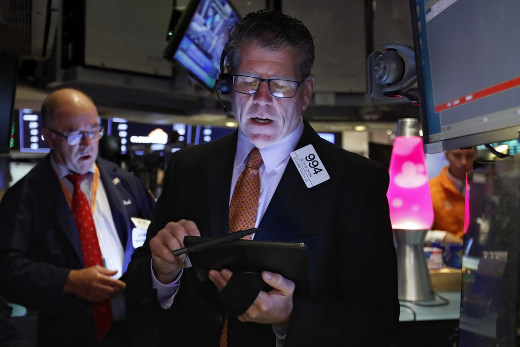 Trader Sean Spain works on the floor of the New York Stock Exchange, Friday, Sept. 13, 2019. Stocks are having a mixed performance early on Wall Stree