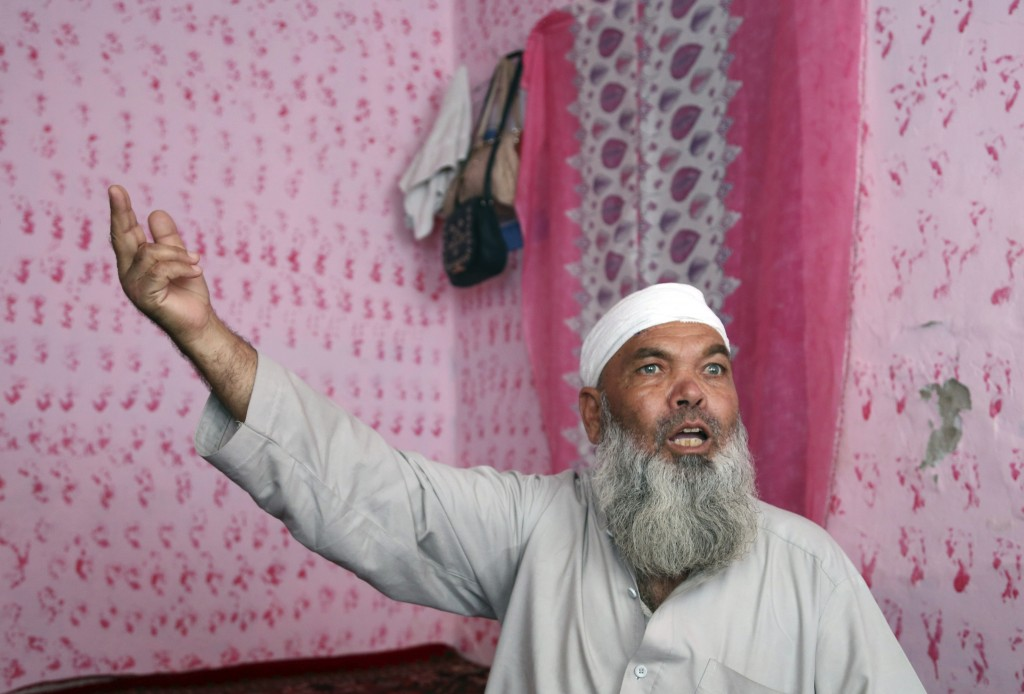 In this Tuesday, Sept. 10, 2019, photo, Hayat Khan, 54, speaks during an interview with The Associated Press after being wounded in a Taliban car bomb...