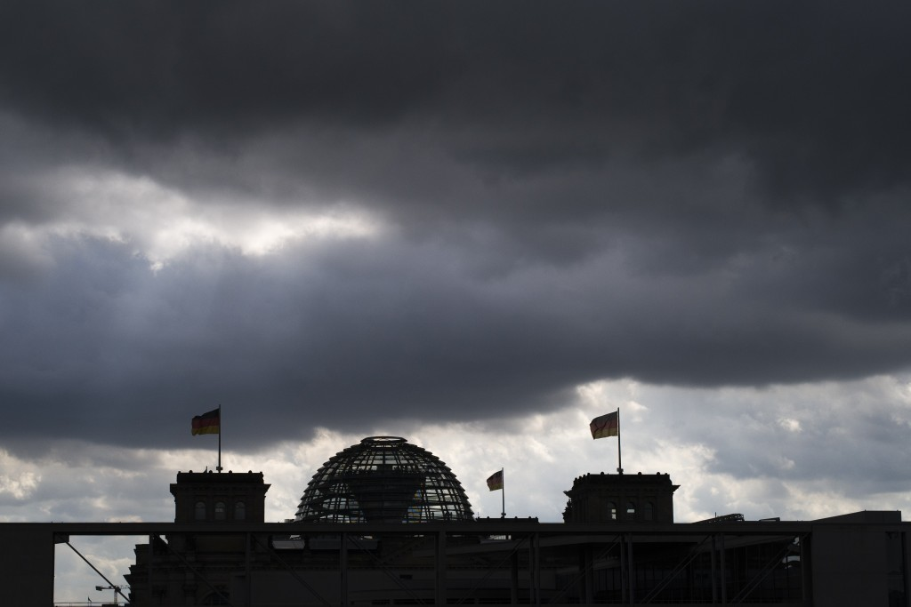 Dark clouds cover the sky over the Reichstag building in Berlin, Germany, Friday, Sept. 13, 2019. The German government says the country's economy is ...