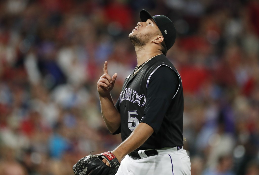 Colorado Rockies relief pitcher Carlos Estevez gestures after striking out St. Louis Cardinals pinch-hitter Jose Martinez with two runners on base to