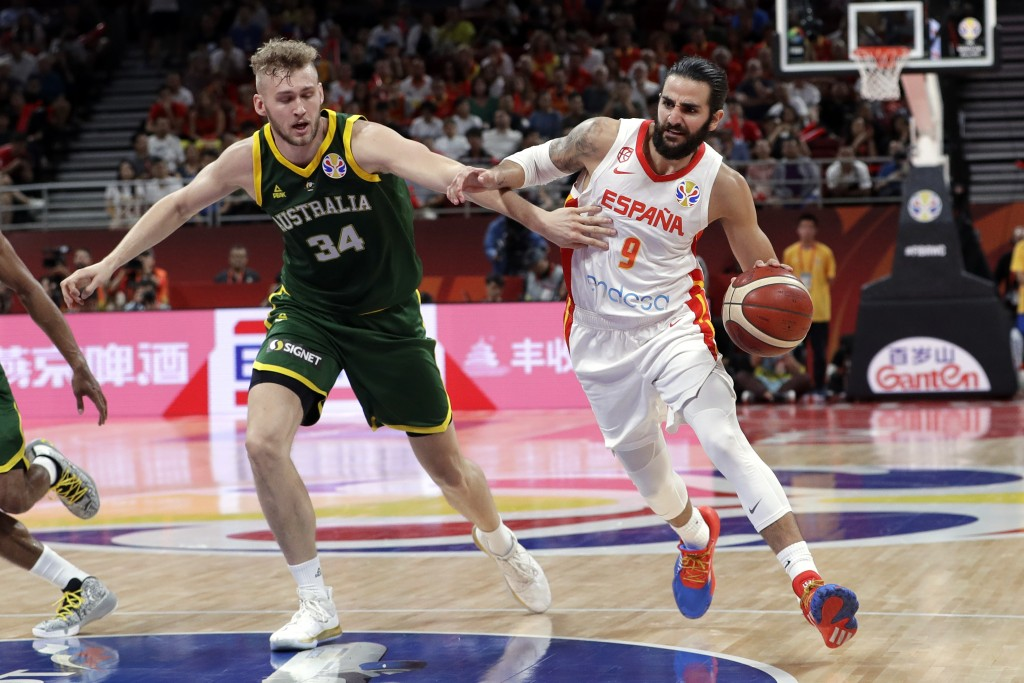 Ricky Rubio of Spain, right, drives past Jock Landale of Australia during their semifinal match in the FIBA Basketball World Cup at the Cadillac Arena