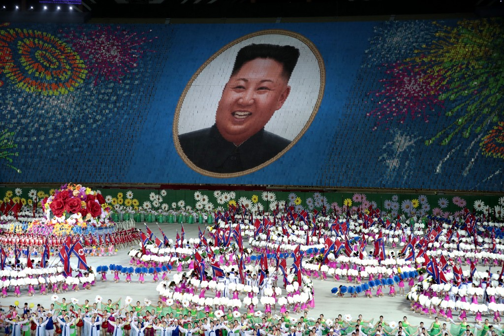 In this Wednesday, Sept. 11, 2019, file photo, performers hold up cards to form a portrait of North Korean leader Kim Jong Un during a mass games perf...