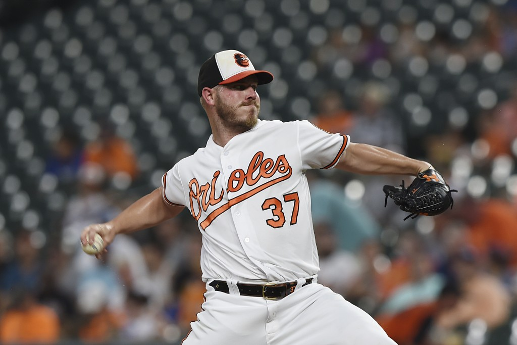 Baltimore Orioles pitcher Dylan Bundy delivers against the Los Angeles Dodgers in the first inning of a baseball game Thursday, Sept. 12, 2019, in Bal...