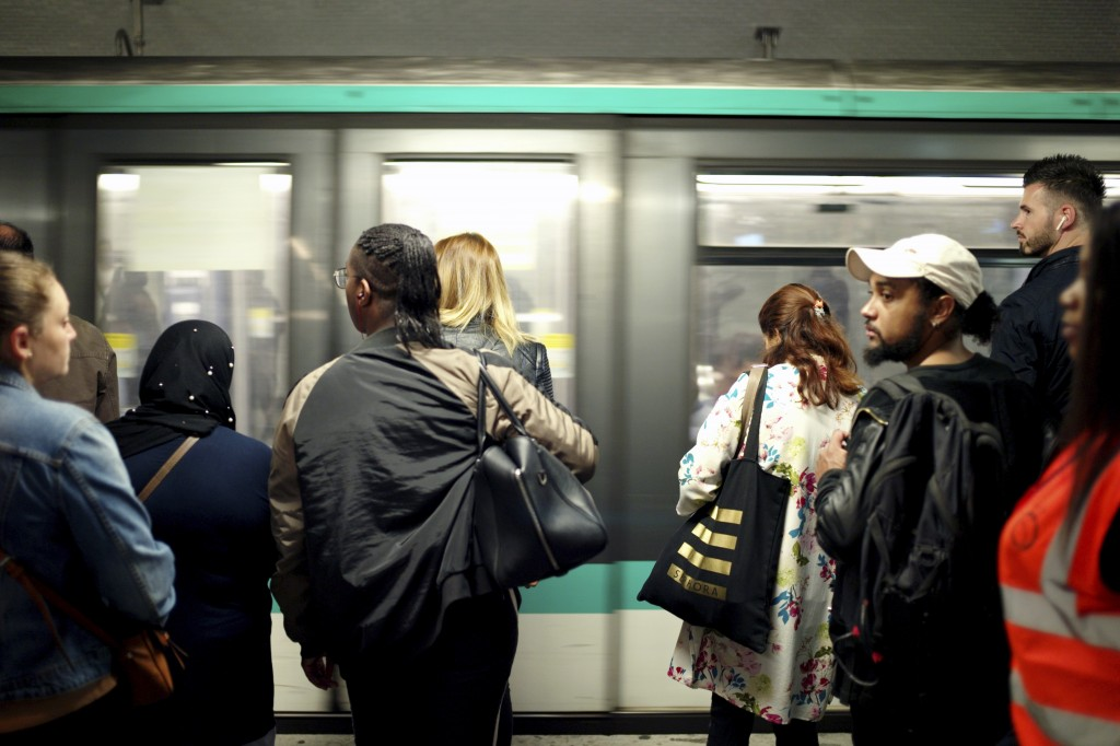 Commuters wait to board a train, in Gare du Nord railway station, in Paris, Friday, Sept. 13, 2019. Paris metro warns over major strike, transport cha