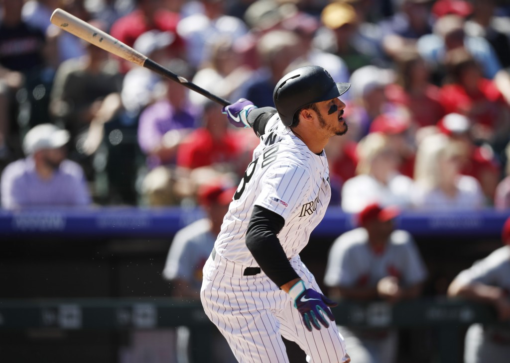 Colorado Rockies' Nolan Arenado follows the flight of his solo home run off St. Louis Cardinals starting pitcher Miles Mikolas in the third inning of ...