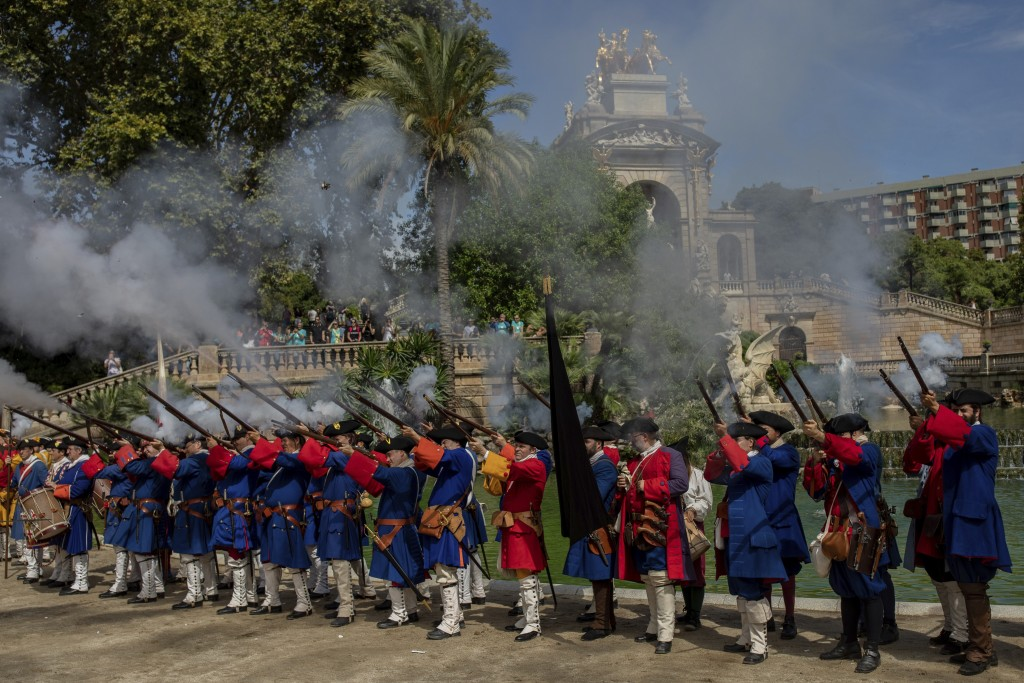 A group reenacts Catalan army units from the War of the Spanish Succession during a performance to celebrate the Catalan National Day in Barcelona, Sp...