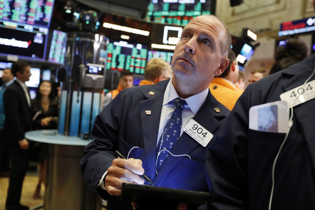 Trader Michael Urkonis works on the floor of the New York Stock Exchange, Friday, Sept. 13, 2019. Stocks are having a mixed performance early on Wall